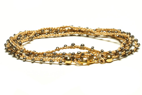 "32"" braided gold silk thread necklace with metallic gold seed beads and gold plated clasp"