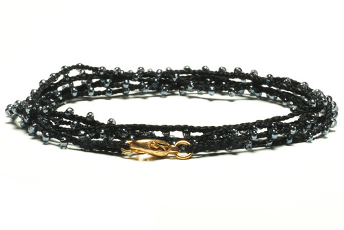 "32"" braided black silk thread necklace with transparent light blue seed beads and gold plated clasp"