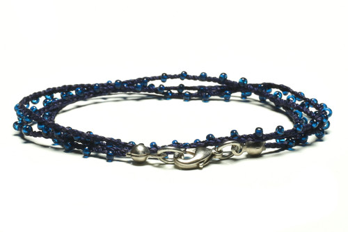 "16"" braided nacy blue silk thread necklace with transparent blue seed beads and silver plated clasp"