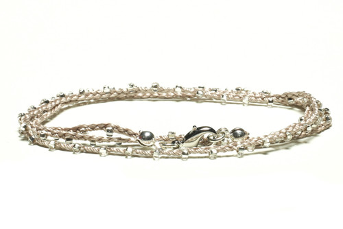 "16"" braided silver silk thread necklace with clear seed beads and silver plated clasp"