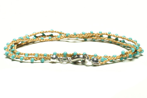 "16"" braided gold silk thread necklace with turquoise seed beads and silver plated clasp"