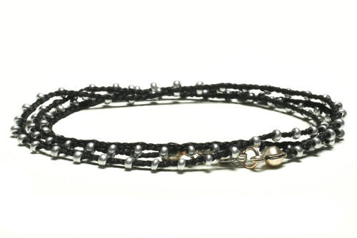 "16"" braided black silk thread necklace with silver seed beads and silver plated clasp"