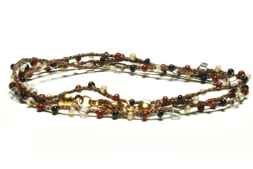 "16"" braided chestnut brown silk thread necklace with clear 2-cut hex, black and burgandy seed beads and gold plated clasp"