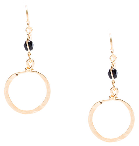 Golden Age hammered dangle small hoop earrings with jet black fire polished crystal bead in gold plate finish. Surgical steel earwire.