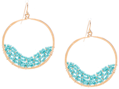 Golden Age hammered circular shaped hoop earrings w. turquoise fire polished crystals. Gold plate finish. Surgical steel earwire.