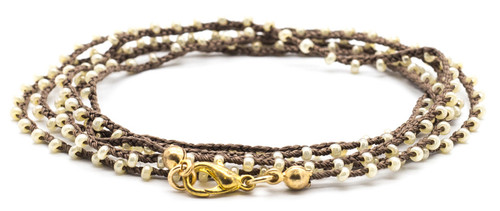 "32"" braided brown silk thread necklace with pearl seed beads and gold plated clasp."