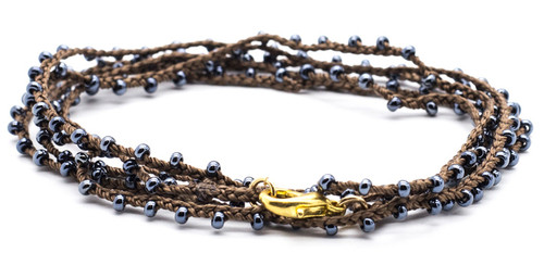 "32"" braided brown silk thread necklace with hematite seed beads and gold plated clasp."