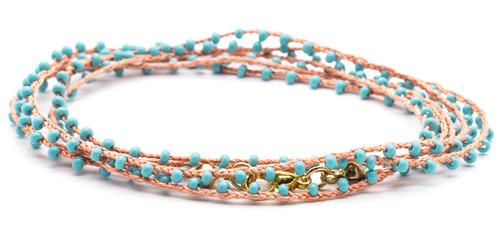 "32"" braided coral silk thread necklace with turquoise seed beads and gold plated clasp."