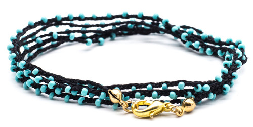 "32"" braided black silk thread necklace with turquoise seed beads and gold plated clasp."