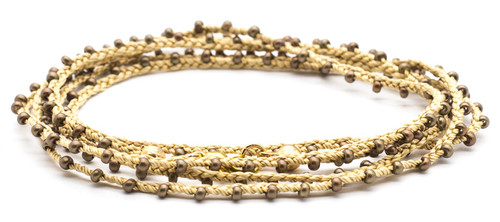 "32"" braided cream silk thread necklace with bronze seed beads and gold plated clasp."