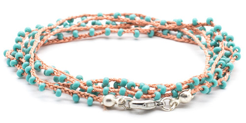 "32"" braided coral silk thread necklace with turquoise seed beads and silver plated clasp."
