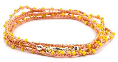 "32"" braided coral silk thread necklace with yellow seed beads and silver plated clasp."