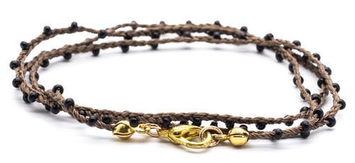 "16"" braided brown silk thread necklace with black seed beads and gold plated clasp."