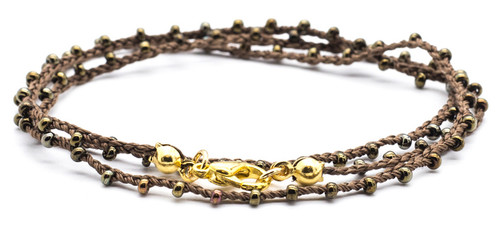 "16"" braided brown silk thread necklace with bronze dorado seed beads and gold plated clasp."