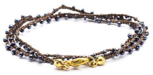 "16"" braided brown silk thread necklace with hematite seed beads and gold plated clasp."