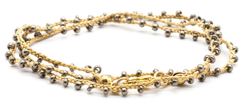 "16"" braided golden silk thread necklace with jet hematite seed beads and gold plated clasp."