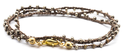 "16"" braided brown silk thread necklace with jet nut bronze seed beads and gold plated clasp."