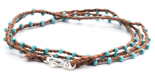 "16"" braided chestnut silk thread necklace with turquoise beads and silver plated clasp."