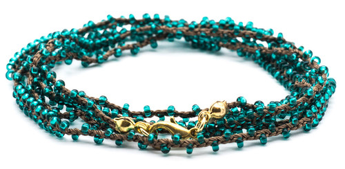 "32"" double braided brown silk thread necklace with emerald seed beads and gold plated clasp."