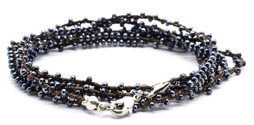 """32"""" double braided brown silk thread necklace with hematite seed beads and silver plated clasp."""