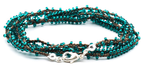 "32"" double braided brown silk thread necklace with emerald seed beads and silver plated clasp."