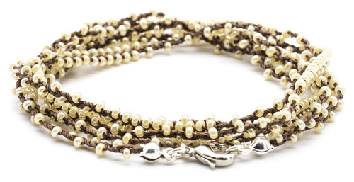 "32"" double braided brown silk thread necklace with pearl seed beads and silver plated clasp."