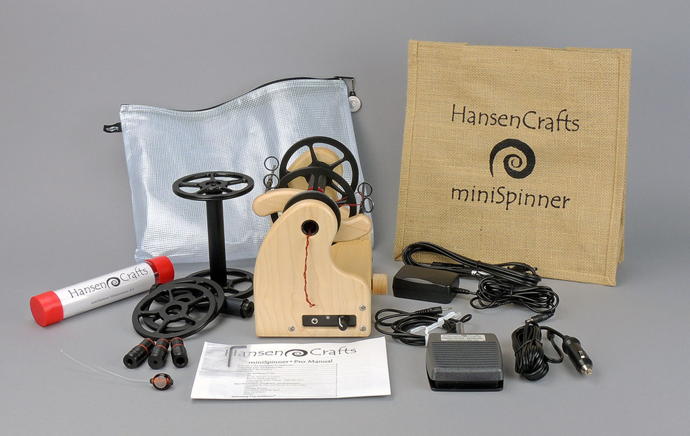 The Ultimate E-Spinner, the HansenCrafts miniSpinner Pro, in Maple! The Pro includes 2 additional HansenCrafts Standard or 3 additional HansenCrafts Lace bobbins, gear bag, maintenance kit, and orifice reducer set.