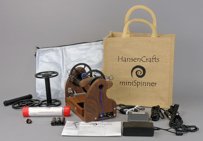The Ultimate E-Spinner, the HansenCrafts miniSpinner Pro, in Walnut! The Pro includes 2 additional HansenCrafts Standard or 3 additional HansenCrafts Lace bobbins, gear bag, maintenance kit, and orifice reducer set.