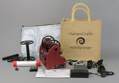 The Ultimate E-Spinner, the HansenCrafts miniSpinner Pro, in Purpleheart! The Pro includes 2 additional HansenCrafts Standard or 3 additional HansenCrafts Lace bobbins, gear bag, maintenance kit, and orifice reducer set.