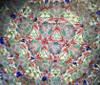 Kaleidoscope - 'Starlet Interchangeable' in Spiral Brass on Dark Wood Stand by Sheryl Koch