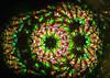 sample interior view of the Large Pedestal Kaleidoscope with Dichroic Glass Wheel in Brass by Jon Greene