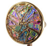 closeup of textured dichroic glass wheel in its secondary position