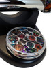 two spare wheels on base, the millefiore glass wheel and underneath that, the smooth dichroic glass wheel