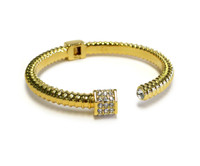 Golden 18k plated Royal Screw, Original Design Liza Schwartz, bracelet has grooves of a screw that is than crowned with the bolt  which has Swarovski Crystal through out, enjoy the elegance and South Beach artistic vibe.