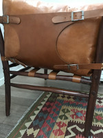 Side straps and leather of chair