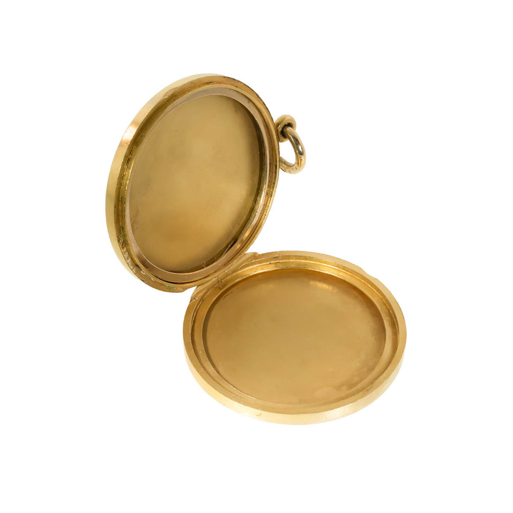 The inside of an 18 ct gold Victorian locket.