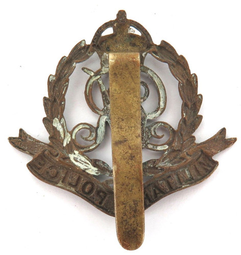 VINTAGE BRITISH MILITARY KGV MILTARY POLICE METAL BADGE WITH SLIDER.