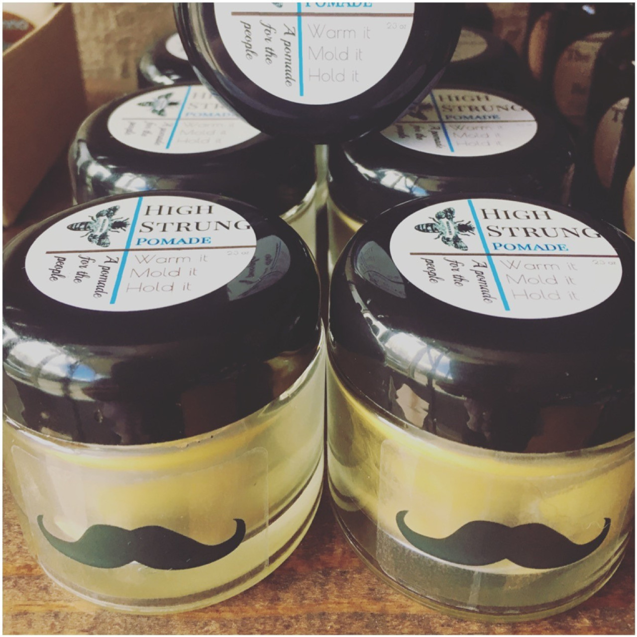 High Strung Pomade: Chemical Free, No silicon, No petroleum products or by-products. High hold.