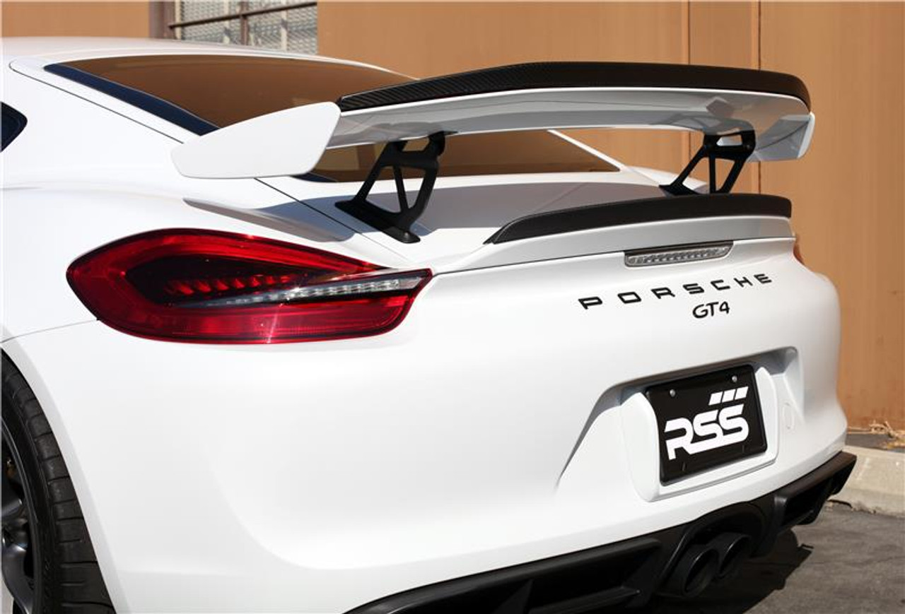 RSS - CarbonAero Kit # 253 for 981 GT4. Includes DUCK TAIL EXTENSION located underneath rear main wing. Aesthetically pleasing and aggressive in appearance, WING EXTENSIONS have a functional purpose with direct benefits on street and motorsports applications. Designed with the latest CAD technology, constructed to exacting standards with pre-preg 2×2 Carbon Fibre Twill, finished in a Matte Clear Coat with UV inhibitors, adhere with 3M VHB tape for easy application and removal, and are 100% Manufactured in USA. Components are of the highest quality and are guaranteed to fit.• Produce down force by deflecting oncoming air upward resulting in a net down force on the rear of the vehicle • Can be used to balance and tune front to rear down force levels