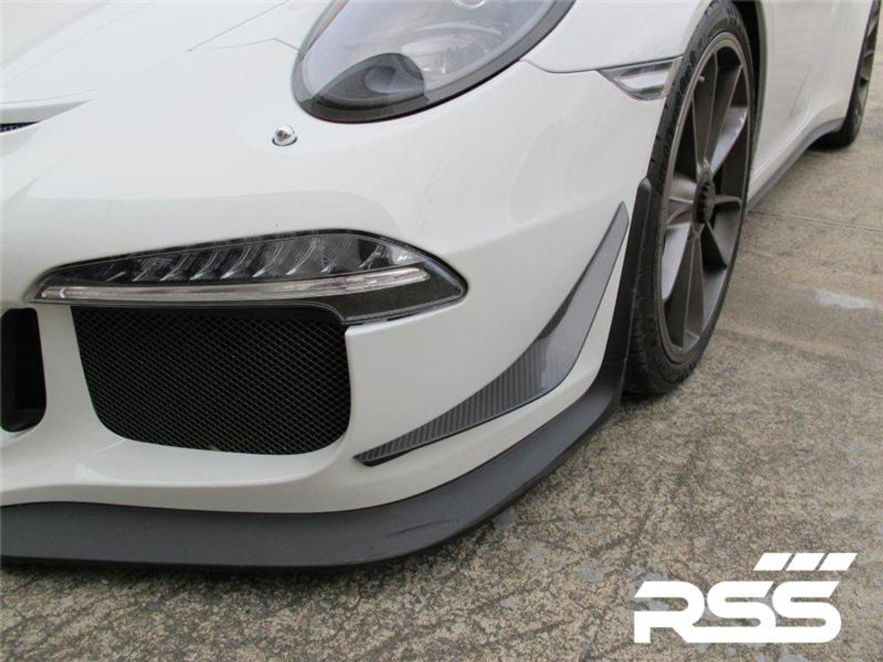 RSS - CarbonAero Kit # 240 for 991.1 GT3 (Does not fit RS). Includes FRONT CANARDS / DIVE PLANES, REAR WING GURNEY FLAP AND REAR ENGINE COVER GURNEY FLAP. Aesthetically pleasing and aggressive in appearance, Canards and Gurney Flaps have a functional purpose with direct benefits on street and motorsports applications. Designed with the latest CAD technology, constructed to exacting standards with pre-preg 2×2 Carbon Fibre Twill, finished in a high gloss clear coat with UV inhibitors, adhere with 3M VHB tape for easy application and removal, and are 100% Manufactured in USA. Components are are of the highest quality and are guaranteed to fit.• Produce down force by deflecting oncoming air upward resulting in a net down force on the front and rear of the vehicle • Can direct air towards other important aero devices or cooling vents • Direct air away from the wheels and tires thereby reducing drag, turbulence and lift • Can be used to balance and tune front to rear down force levels
