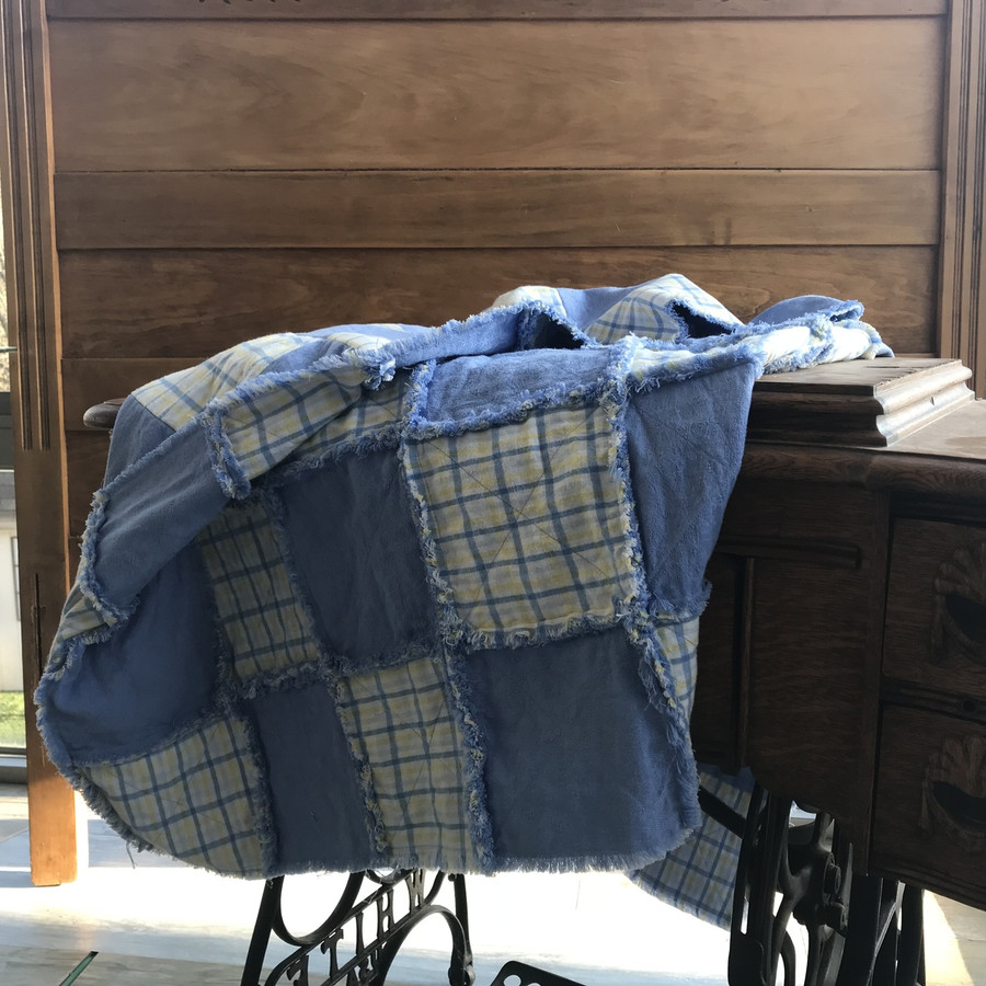 """5 1/2"""" squares alternate on this quilt, seam allowances are ragged, soft, and fuzzy. Cotton fabrics, cotton batting, and machine sewn."""