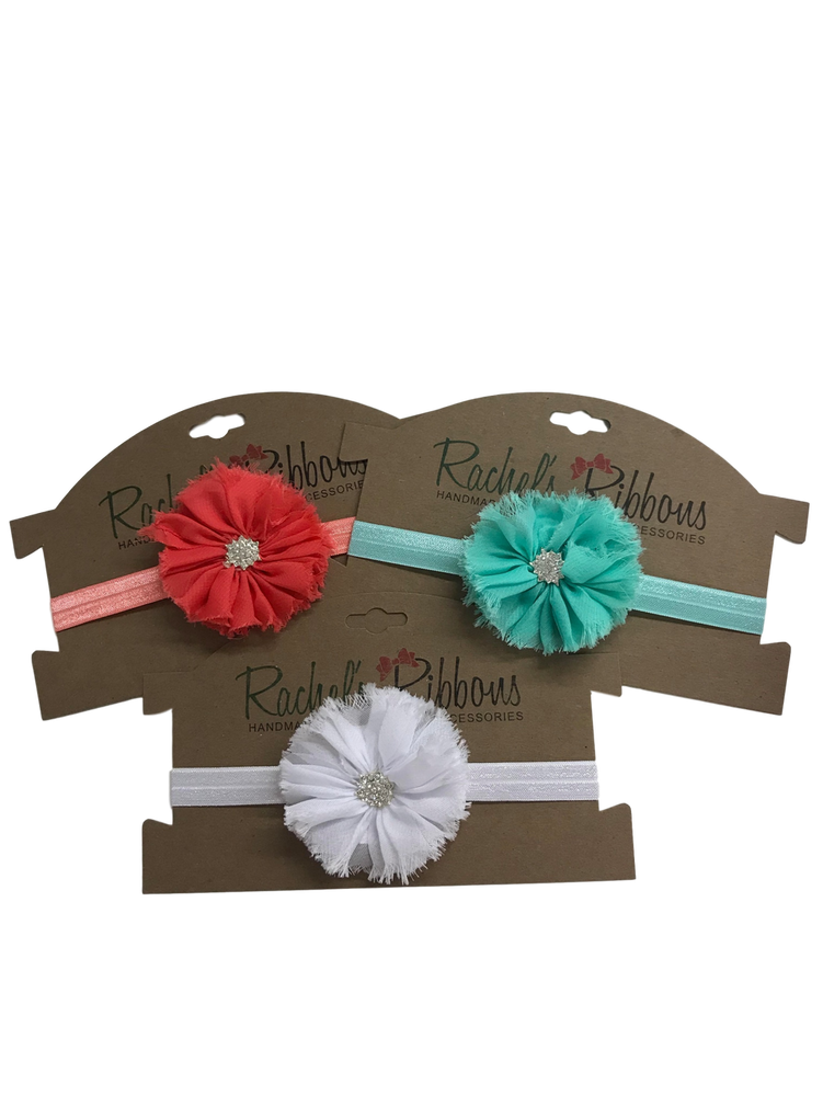 """The stunning jewel styling and color palette make this a welcome addition to any outfit.  Our delicate and perfectly shabby Jewel Ballerina Flower is attached to a 5/8"""" width Satin Stretch Headband.  Overall width is approximately 6"""", comfortably stretches to approximately 9"""".  Flower and headband match, unless otherwise requested.  Perfect for newborn through toddler."""
