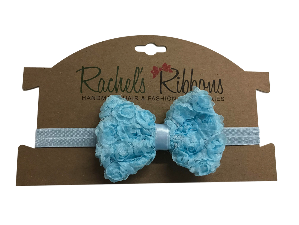 """Our adorable Shabby Rose Bow flower is attached to a 5/8"""" width Satin Stretch Headband.  Overall width is approximately 6"""", comfortably stretches to approximately 9"""".  Flower and headband match, unless otherwise requested.  Perfect for newborn through toddler."""