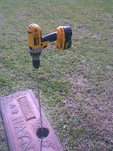 The Turf-Tec Cemetery Vase Clean Out Tool is simply inserted into a cordless drill and placed into the monument vase to be cleaned out.