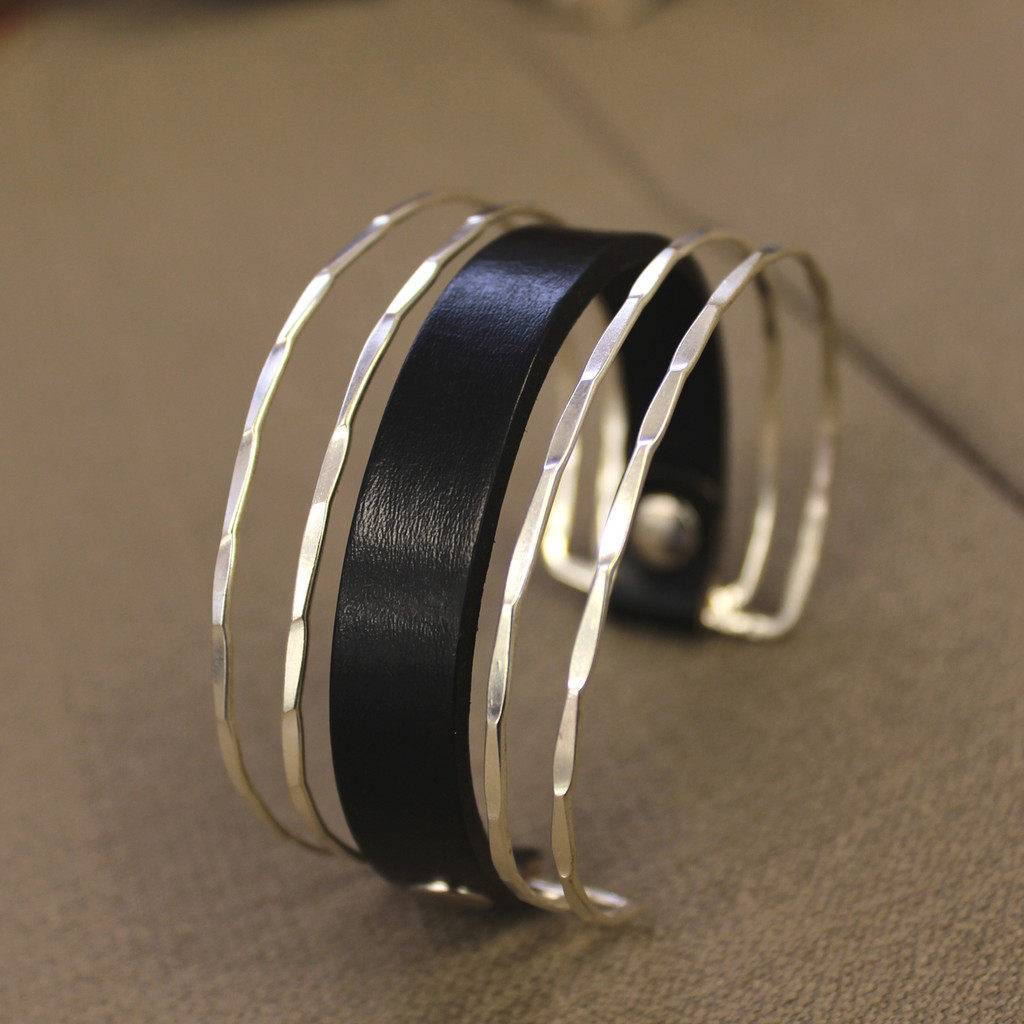 Unique silver cuff with black leather detail