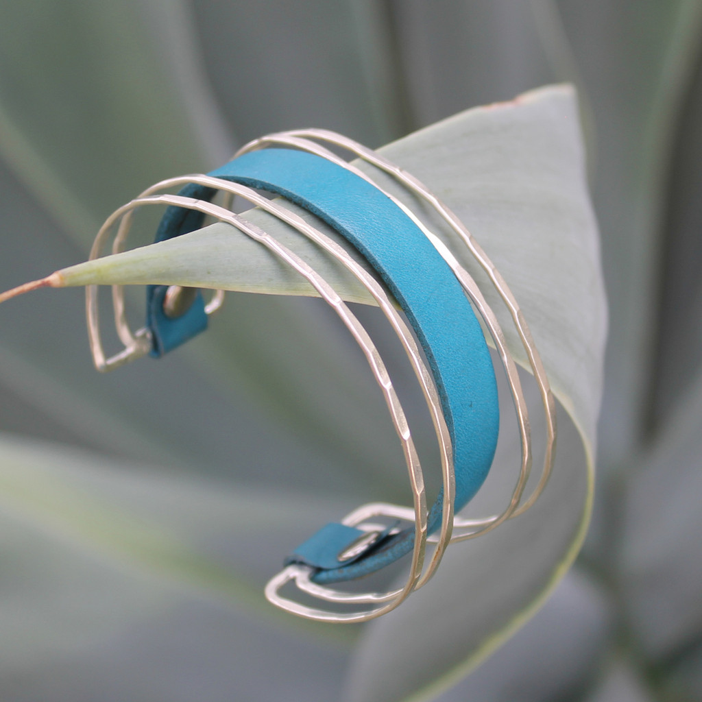 Unique brass cuff with turquoise leather detail