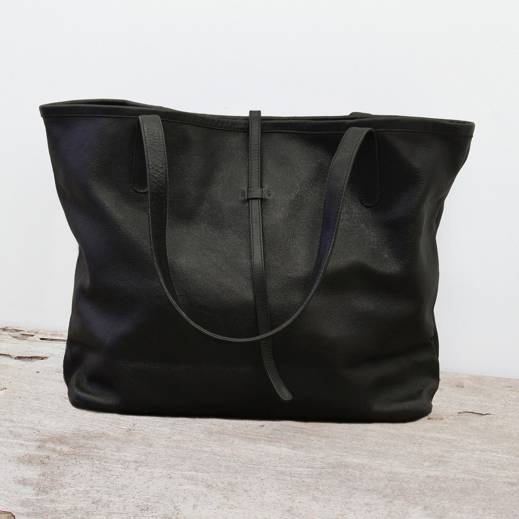 black leather tote bag with minimalist closure