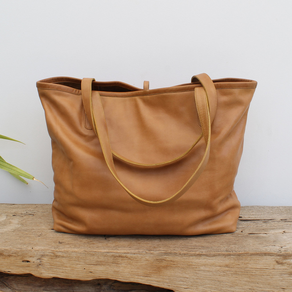 caramel leather tote bag with minimalist closure