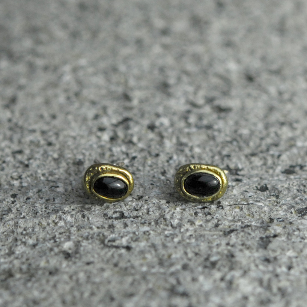 brass earrings with black onyx detailing and sterling silver earring posts