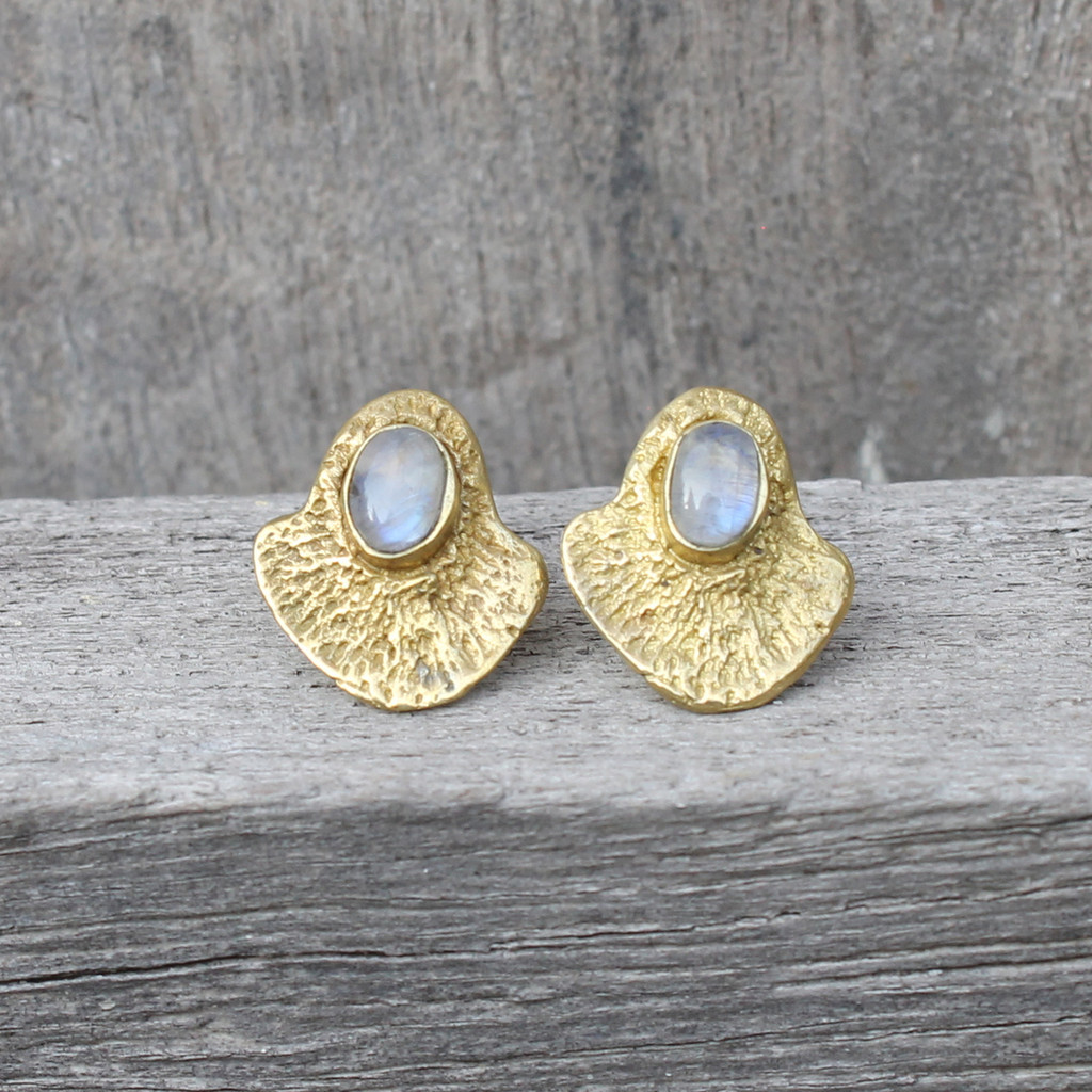 brass textured studs with a bold bezel and moonstone detail